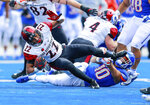 San Diego State running back Chase Jasmin (22) is tripped up by Boise State safety Kekoa Nawahine (10) in the first half of an NCAA college football game, Saturday, Oct. 6, 2018, in Boise, Idaho. (AP Photo/Steve Conner)