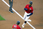 Minnesota Twins Byron Buxton rounds third base on a two-run home run off Texas Rangers' pitcher Kyle Gibson in the first inning of a baseball game, Tuesday, May 4, 2021, in Minneapolis. (AP Photo/Jim Mone)