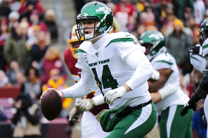 New York Jets quarterback Sam Darnold (14) scrambles during the first half of an NFL football game against the Washington Redskins, Sunday, Nov. 17, 2019, in Landover, Md. (AP Photo/Mark Tenally)