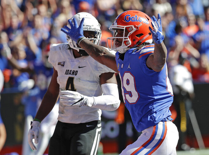 Florida wide receiver Tyrie Cleveland, right, celebrates after catching a 34-yard touchdown pass in front of Idaho defensive back Denzal Brantley, left, during the first half of an NCAA college football game, Saturday, Nov. 17, 2018, in Gainesville, Fla. (AP Photo/John Raoux)