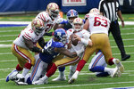 San Francisco 49ers quarterback Nick Mullens, center, is sacked by New York Giants Leonard Williams (99) during the first half of an NFL football game, Sunday, Sept. 27, 2020, in East Rutherford, N.J. (AP Photo/Corey Sipkin)
