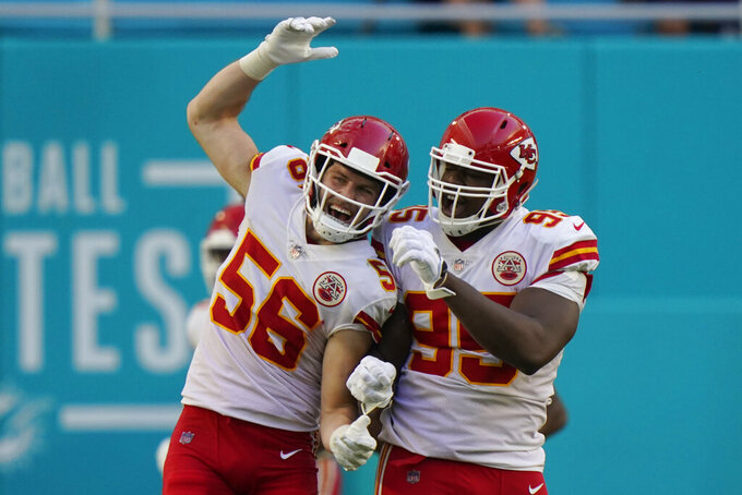Kansas City Chiefs outside linebacker Ben Niemann (56) and defensive tackle Chris Jones (95) celebrate after Jones sacked Miami Dolphins quarterback Tua Tagovailoa in the enzone for a safety, during the second half of an NFL football game, Sunday, Dec. 13, 2020, in Miami Gardens, Fla. (AP Photo/Lynne Sladky)