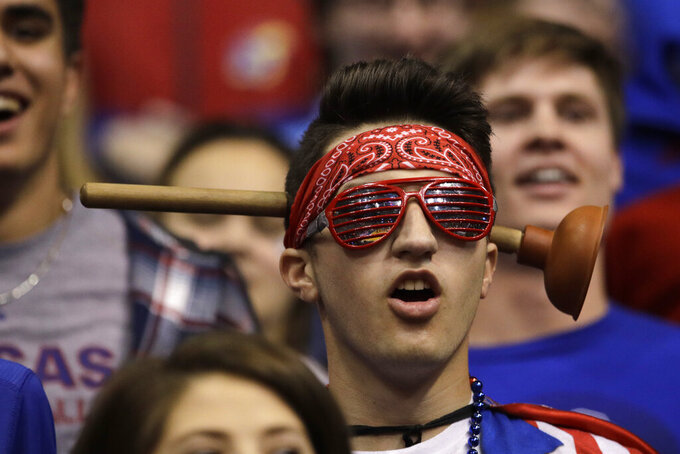 A Kansas fan watches during the first half of an NCAA college basketball game against East Tennessee State Tuesday, Nov. 19, 2019, in Lawrence, Kan. (AP Photo/Charlie Riedel)