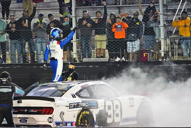 Chase Briscoe celebrates winning the NASCAR Xfinity Series auto race Friday, Sept. 18, 2020, in Bristol, Tenn. (AP Photo/Steve Helber)