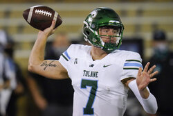 Tulane quarterback Michael Pratt throws a pass during the first half of the team's NCAA college football game against Tulsa in Tulsa, Okla., Thursday, Nov. 19, 2020. (AP Photo/Sue Ogrocki)
