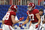 Alabama tight end Miller Forristall (87) celebrates with Major Tennison (88) after catching a touchdown pass in the first half of an NCAA college football game against Duke, Saturday, Aug. 31, 2019, in Atlanta. (AP Photo/John Bazemore)