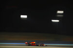 Red Bull driver Max Verstappen of the Netherlands steers his car during the second free practice at the Formula One Bahrain International Circuit in Sakhir, Bahrain, Friday, Nov. 27, 2020. (Brynn Lennon, Pool via AP)