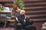 Democratic presidential contender Elizabeth Warren greets House Majority Whip Jim Clyburn at the funeral of his wife Emily on Sunday, Sept. 22, 2019, in West Columbia, S.C. (AP Photo/Meg Kinnard)