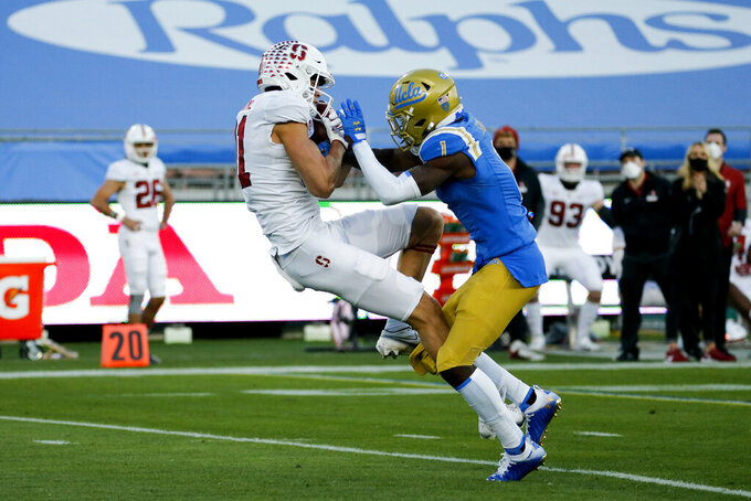 Stanford wide receiver Brycen Tremayne (81) catches a pass while defended by UCLA defensive back Jay Shaw (1) during the first half of an NCAA college football game Saturday, Dec. 19, 2020, in Pasadena, Calif. (AP Photo/Ringo H.W. Chiu)
