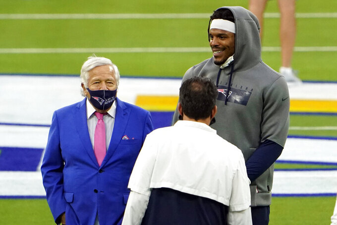 New England Patriots owner Robert Kraft, left, stands next to quarterback Cam Newton before an NFL football game against the Los Angeles Rams Thursday, Dec. 10, 2020, in Inglewood, Calif. (AP Photo/Jae C. Hong)