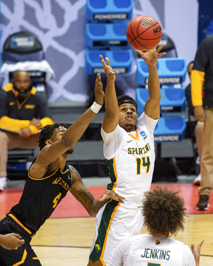 Norfolk State guard Devante Carter (14) beats Appalachian State forward RJ Duhart (4) to a rebound during the first half of a First Four game in the NCAA men's college basketball tournament, Thursday, March 18, 2021, in Bloomington, Ind. (AP Photo/Doug McSchooler)