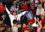 A supporter of President Donald Trump reacts upon his arrival to a campaign rally at the Santa Ana Star Center, Monday, Sept. 16, 2019, in Rio Rancho, N.M. (AP Photo/Andres Leighton)