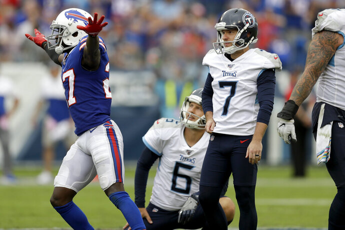 Buffalo Bills cornerback Tre'Davious White (27) celebrates as Tennessee Titans kicker Cairo Santos (7) and holder Brett Kern (6) watch as Santos misses his fourth straight field goal attempt in the second half of an NFL football game Sunday, Oct. 6, 2019, in Nashville, Tenn. (AP Photo/James Kenney)