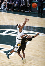 Michigan State's Cassius Winston, left, shoots over Purdue's Eric Hunter Jr. during the first half of an NCAA college basketball game, Tuesday, Jan. 8, 2019, in East Lansing, Mich. (AP Photo/Al Goldis)
