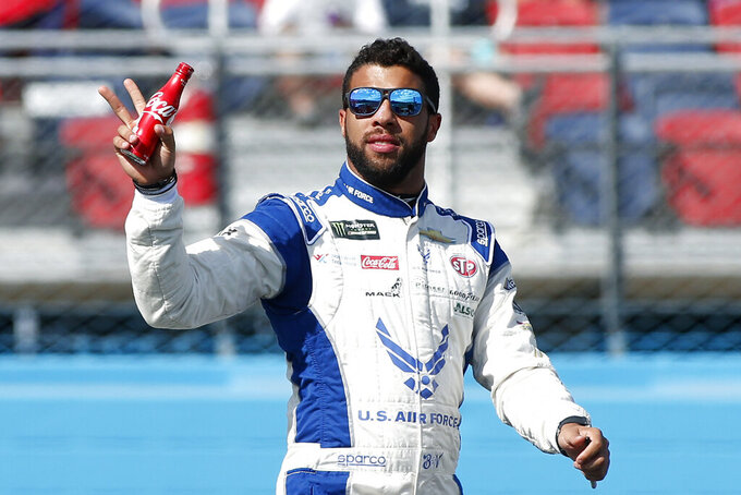 Bubba Wallace waves during driver introductions prior to the NASCAR Cup Series auto race at ISM Raceway, Sunday, Nov. 10, 2019, in Avondale, Ariz. (AP Photo/Ralph Freso)