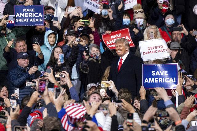 President Donald Trump arrives at a rally for U.S. Senators Kelly Loeffler, R-Ga., and David Perdue, R-Ga., who are both facing runoff elections Saturday, Dec. 5, 2020, in Valdosta, Ga. (AP Photo/Ben Gray)