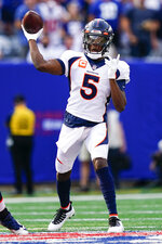 Denver Broncos quarterback Teddy Bridgewater (5) throws a pass during the first half of an NFL football game against the New York Giants, Sunday, Sept. 12, 2021, in East Rutherford, N.J. (AP Photo/Matt Rourke)