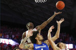 Kentucky forward Nick Richards (4) and Georgia guard Jordan Harris, upper left, vie for a rebound during the second half of an NCAA college basketball game Tuesday, Jan. 7, 2020, in Athens, Ga. Kentucky won 78-69. (AP Photo/John Bazemore)