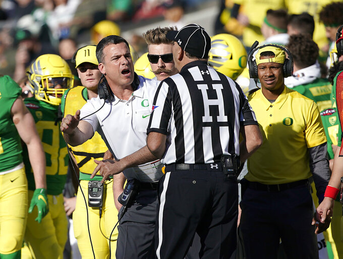Oregon coach Mario Cristobal argues a call with the head linesman during the second half against Michigan State in the Redbox Bowl NCAA college football game Monday, Dec. 31, 2018, in Santa Clara, Calif. Oregon won 7-6. (AP Photo/Tony Avelar)