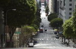 Traffic is light on Grand Avenue in downtown Los Angeles as stay-at-home orders due to coronavirus continue in the city, Wednesday, March 25, 2020. (AP Photo/Chris Pizzello)