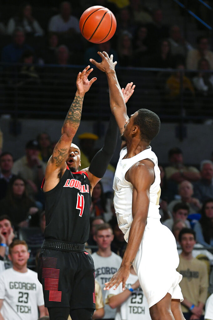 Louisville guard Khwan Fore (4) shoots as Georgia Tech guard Curtis Haywood II defends during the first half of an NCAA college basketball game Saturday, Jan. 19, 2019, in Atlanta. (AP Photo/John Amis)