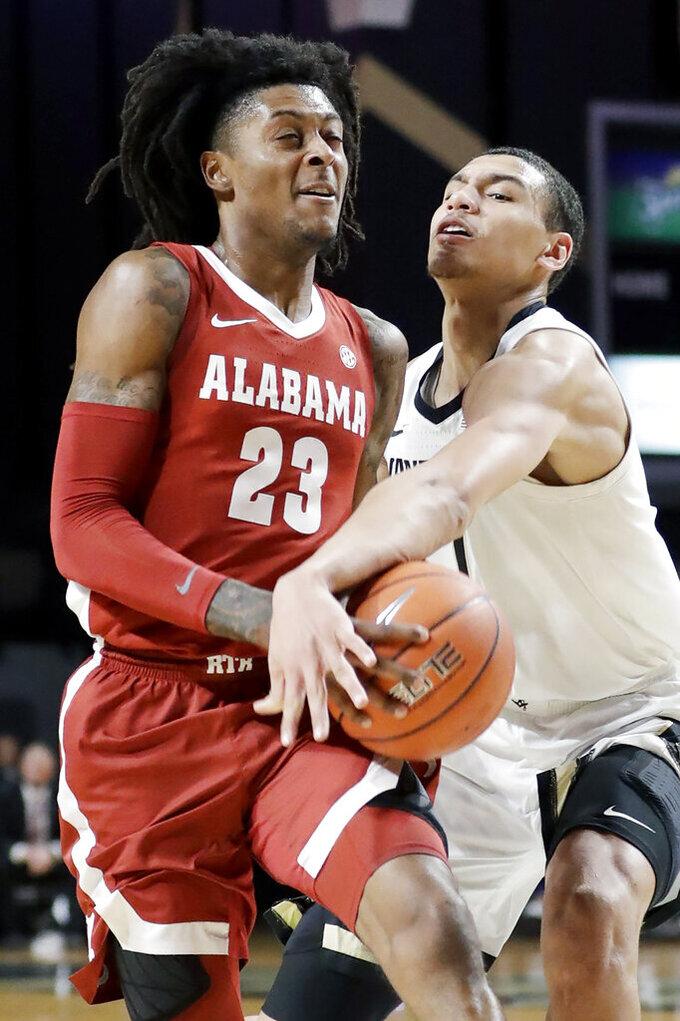 Alabama guard John Petty Jr. (23) drives against Vanderbilt forward Dylan Disu in the second half of an NCAA college basketball game Wednesday, Jan. 22, 2020, in Nashville, Tenn. (AP Photo/Mark Humphrey)