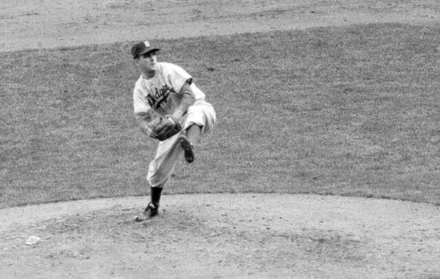 FILE - In this October 1952 file photo, Brooklyn Dodgers' Carl Erskine pitches against the New York Yankees in Game 5 of the baseball World Series in New York. Up by 13 1/2 games in mid-August in 1951, Jackie Robinson and the Dodgers seemed destined. That was until rookie Willie Mays and the New York Giants came flying back, fueled by an incredible, late run in home games at the Polo Grounds, and forced a best-of-three playoff for the National League pennant. Erskine was warming up in the Brooklyn bullpen in Game 3 when Bobby Thomson connected for the famed