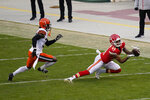 Kansas City Chiefs wide receiver Demarcus Robinson (11) catches a pass ahead of Cleveland Browns cornerback Terrance Mitchell, left, during the second half of an NFL divisional round football game, Sunday, Jan. 17, 2021, in Kansas City. (AP Photo/Orlin Wagner)