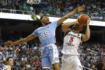 North Carolina guard Christian Keeling (55) blocks Virginia Tech guard Wabissa Bede (3) during the second half of an NCAA college basketball game at the Atlantic Coast Conference tournament in Greensboro, N.C., Tuesday, March 10, 2020. (AP Photo/Ben McKeown)