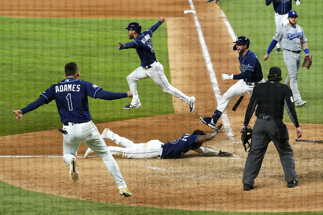 during the == inning in Game 4 of the baseball World Series Saturday, Oct. 24, 2020, in Arlington, Texas. Rays defeated the Dodgers 8-7 to tie the series 2-2 games. (AP Photo/Eric Gay)