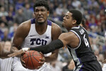 TCU center Kevin Samuel, left, is fouled by Kansas State guard David Sloan (4) during the second half of an NCAA college basketball game in the first round of the Big 12 men's tournament in Kansas City, Mo., Wednesday, March 11, 2020. Kansas State defeated TCU 53-49. (AP Photo/Orlin Wagner)