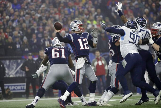 New England Patriots quarterback Tom Brady, center, passes under pressure from Tennessee Titans defensive end DaQuan Jones (90) and linebacker Derick Roberson (50) in the first half of an NFL wild-card playoff football game, Saturday, Jan. 4, 2020, in Foxborough, Mass. (AP Photo/Elise Amendola)