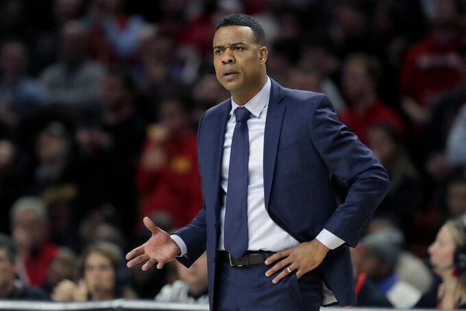 Rhode Island head coach David Cox talks to an official during the first half of an NCAA college basketball game against Maryland, Saturday, Nov. 9, 2019, in College Park, Md. (AP Photo/Julio Cortez)