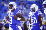 Kentucky quarterback Terry Wilson (3) celebrates after scoring a touchdown during the first half of an NCAA college football game against Mississippi, Saturday, Oct. 3, 2020, in Lexington, Ky. (AP Photo/Bryan Woolston)