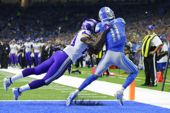 Detroit Lions wide receiver Marvin Jones (11), defended by Minnesota Vikings cornerback Xavier Rhodes (29) catches an 11-yard pass for a touchdown during the first half of an NFL football game, Sunday, Oct. 20, 2019, in Detroit. (AP Photo/Duane Burleson)