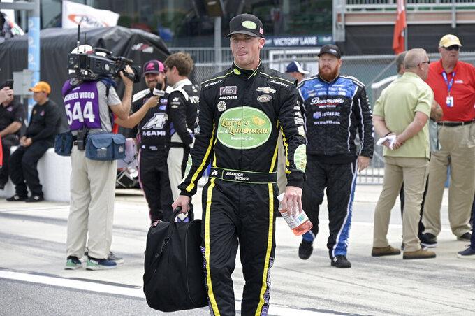 Driver Brandon Brown walks to his vehicle on pit road before a NASCAR Xfinity Series auto race at Daytona International Speedway, Saturday, Aug. 28, 2021, in Daytona Beach, Fla. (AP Photo/Phelan M. Ebenhack)