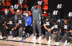 Orlando Magic's Jonathan Isaac stands during the national anthem before the team's NBA basketball game against the Sacramento Kings on Sunday, Aug. 2, 2020, in Lake Buena Vista, Fla. (Charles King/Orlando Sentinel via AP)