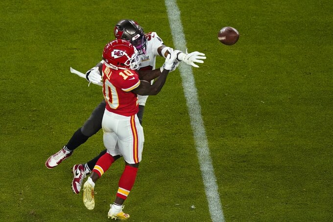 Tampa Bay Buccaneers' Mike Edwards (32) defends a pass intended for Kansas City Chiefs' Tyreek Hill (10) during the second half of the NFL Super Bowl 55 football game Sunday, Feb. 7, 2021, in Tampa, Fla. (AP Photo/Charlie Riedel)