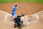 Philadelphia Phillies' J.T. Realmuto hits a two-run home run off Baltimore Orioles pitcher Tom Eshelman during the fourth inning of a baseball game, Thursday, Aug. 13, 2020, in Philadelphia. (AP Photo/Matt Slocum)