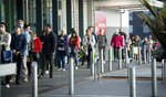 People queue early morning outside a supermarket in Hobsonville, Auckland, as New Zealand prepares to move into Covid-19 Alert Level 3, Wednesday, Aug. 12, 2020. New Zealand Prime Minister Jacinda Ardern said Tuesday, Aug. 11 authorities have found four cases of the coronavirus in one Auckland household from an unknown source, the first reported cases of local transmission in the country in 102 days. (Dean Purcell/New Zealand Herald via AP)