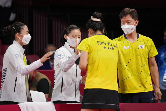 South Korea team gesture after winning the table tennis women's team round of 16 against Poland at the 2020 Summer Olympics, Monday, Aug. 2, 2021, in Tokyo. (AP Photo/Kin Cheung)