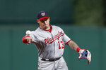 FILE - In this Wednesday, Aug. 21, 2019 file photo, Washington Nationals third baseman Asdrubal Cabrera throws out Pittsburgh Pirates' Jacob Stallings on a ground ball in the seventh inning of a baseball game in Pittsburgh. The Washington Nationals are bringing back Asdrúbal Cabrera after he helped them in their second-half surge last season. Cabrera agreed to a $2.5 million, one-year deal, Wednesday, Jan. 8, 2020. He is part of a group of infielders Washington either re-signed or added in free agency as the team creates depth and flexibility. (AP Photo/Keith Srakocic, File)