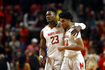 Maryland forwards Bruno Fernando, left, of Angola, and Ricky Lindo Jr. embrace after an NCAA college basketball game against Wisconsin, Monday, Jan. 14, 2019, in College Park, Md. Maryland won 64-60. (AP Photo/Patrick Semansky)