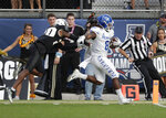 Memphis running back Darrell Henderson (8) runs for a 62-yard touchdown past Central Florida defensive back Brandon Moore, left, during the first half of the American Athletic Conference championship NCAA college football game, Saturday, Dec. 1, 2018, in Orlando, Fla. (AP Photo/John Raoux)