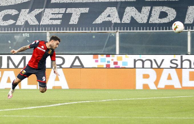 Genoa's Antonio Sanabria scores a goal during a serie A soccer match between Genoa and Verona, at the Luigi Ferraris stadium in Genoa, Italy, Sunday, Aug. 2, 2020. (Tano Pecoraro/Lapresse via AP)