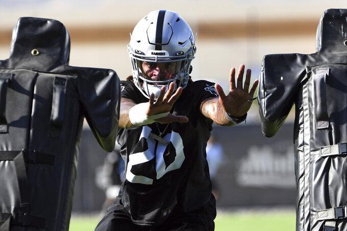 Las Vegas Raiders corner back Damon Arnette performs drills during an NFL football practice Wednesday, July 28, 2021, in Henderson. (AP Photo/David Becker)