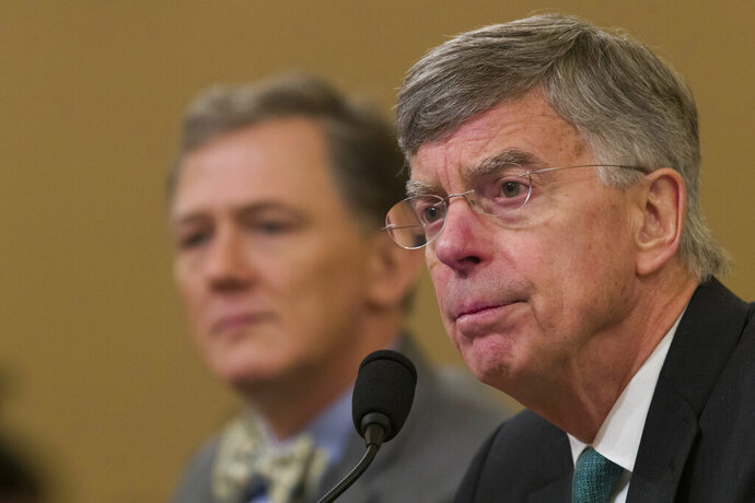 Career Foreign Service officer George Kent, left, and top U.S. diplomat in Ukraine William Taylor testify during an impeachment hearing of the House Intelligence Committee on Capitol Hill, Wednesday Nov. 13, 2019 in Washington. (AP Photo/Alex Brandon)