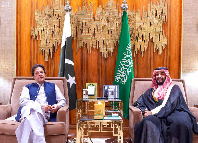 In this Tuesday, Oct, 15, 2019, photo released by Saudi Press Agency, SPA, Saudi Arabia's Crown Prince Mohammed bin Salman, right, meets with Pakistani Prime Minister Imran Khan, in Riyadh, Saudi Arabia. Khan's visit comes after traveling on Sunday to Iran, where he met President Hassan Rouhani and Supreme Leader Ayatollah Ali Khamenei. (Saudi Press Agency via AP)