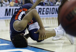 Auburn's Chuma Okeke grabs his leg after being injured on his way to the basket during the second half of a men's NCAA tournament college basketball Midwest Regional semifinal game against North Carolina, Friday, March 29, 2019, in Kansas City, Mo. (AP Photo/Charlie Riedel)