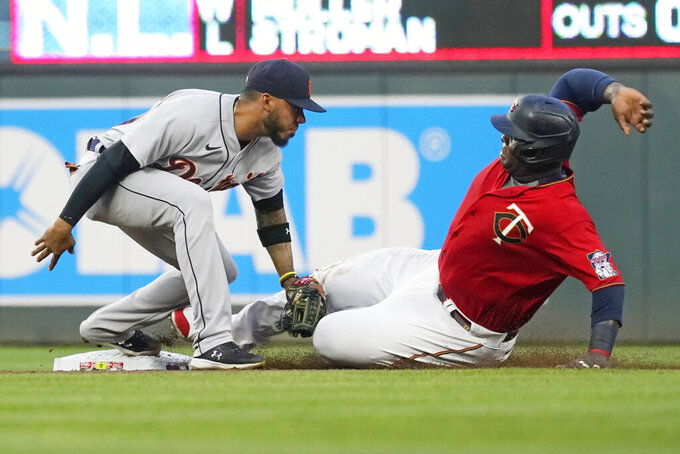 Detroit Tigers shortstop Harold Castro, left, tags out Minnesota Twins' Miguel Sano on a steal-attempt in the fourth inning of a baseball game, Monday, July 26, 2021, in Minneapolis. (AP Photo/Jim Mone)